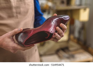 close up of a shoe in cobbler hands