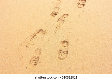 Close up of shoe prints in clean sand