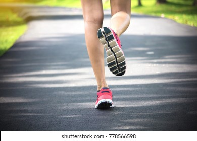 Close up shoes, legs. sport runner woman back view running, girl walking in park. Sport exercise benefit. workout outdoor. weight loss body strong. Slow walking benefits from sport challenge concept.