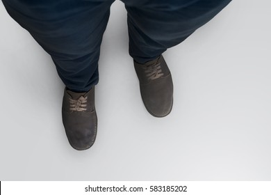 Close up of shoes man walking top view