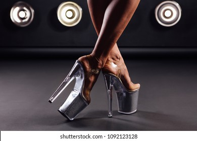 Close up shoes for pole dance with high heels on legs