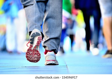 Close up of shoes walking on street