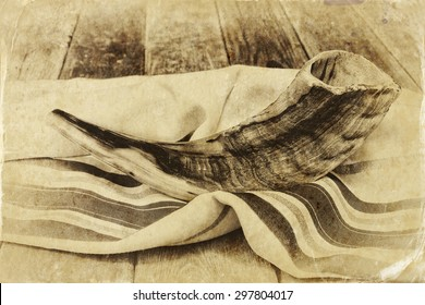 close up of shofar (horn) on white prayer talit. room for text. rosh hashanah (jewish holiday) concept . traditional holiday symbol. old style photo