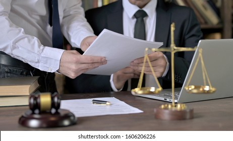 Close up Shoot of Advocate Working with Assistant