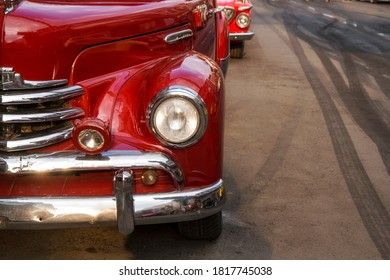 close up shoot of headlight and bumper of red classic plymouth car - Batu, Malang 12 September 2020