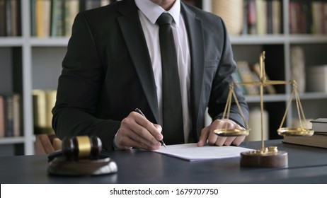 Close up Shoot of Lawyer Hand Checking Document in Court Room