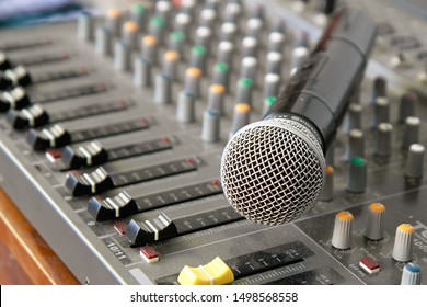 close up shoot of microphone on the audio mixer console