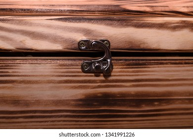 Close up shoot of vintage wooden box or casket with chest lock, wooden texture.