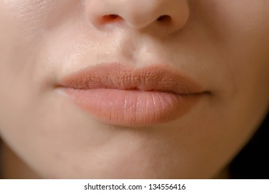 Close up shoot of young beautiful girl with perfect skin: makeup mouth zone. Lips.