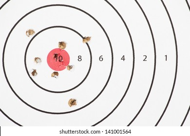 Close up of a shooting target and bullseye with bullet holes