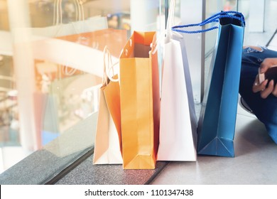 Close up of shopping bags on floor in department store, Lifestyle and shopping concept