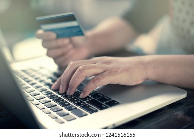 Close Up Shopping Online With Laptop And Credit Card