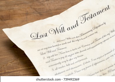 Close up shot of an aged last will and testament on a wooden table top