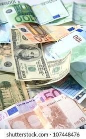 close up shot of American dollar and euro banknote