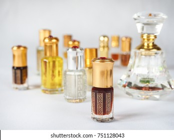 Close up shot of arabian oud oil made of agar wood in a beautiful glass jar.
