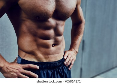 Close shot of athletic well built man with six pack abs