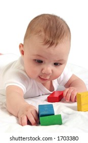 Close up shot of baby interested in colorful blocks.