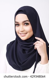 close up shot of beautiful asian muslimah woman with office attire showing different expression