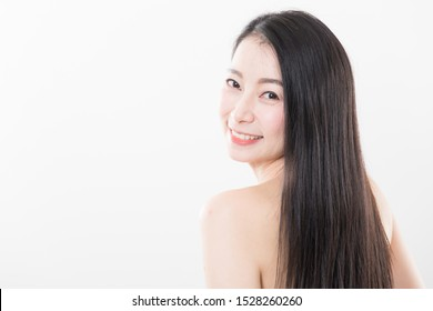 close up shot of beautiful asian woman with smooth long dark brown hair smile from the back isolated on white background
