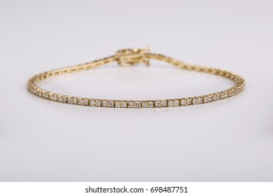 Close up shot of beautiful diamond bracelets on white background