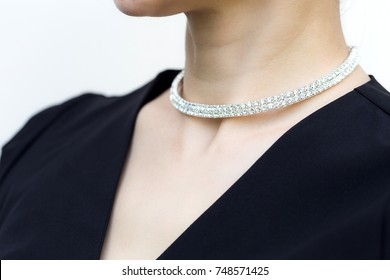 Close up shot of beautiful silver necklace on woman neck