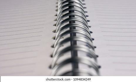 Close up shot of a blank spiral notebook