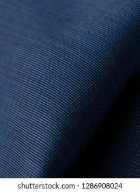 Close up shot of blue suit fabric.