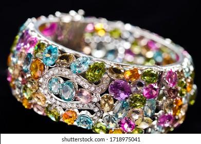 close up shot, bracelet with gems on black background