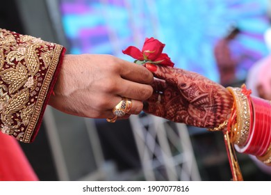 Close up shot of a bride and groom greeting for the first time after marriage ceremony