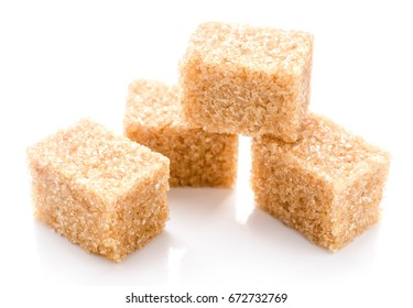Close up shot of brown cane sugar isolated