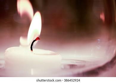 Close up shot of burning white candle