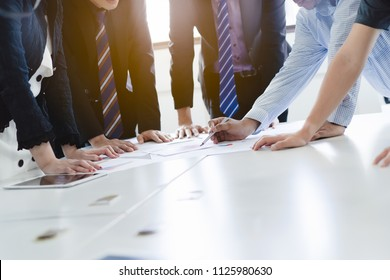 Close up shot business people team meeting in conference room in company. Businessman pointing pen at document on the table.