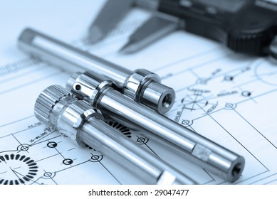 close up shot of a calliper with part on  Engineering drawing background