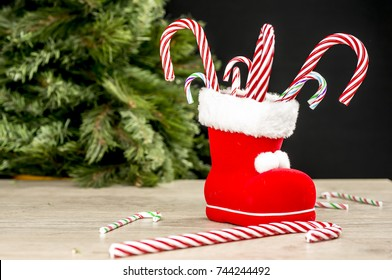 Close up shot of candy canes inside a red Christmas boot