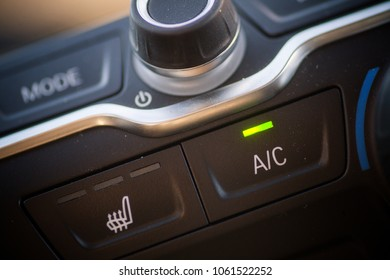 Close up shot of a car air conditioning button.