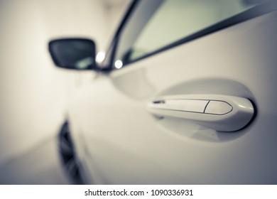 Close up shot of a car door handle.