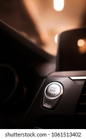 Close up shot of a car start/stop button.