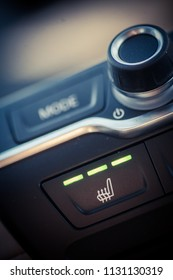Close up shot of a car's heated seats button.