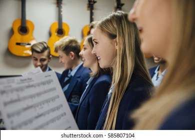 Close up shot of choir students singing in their music lesson at school.