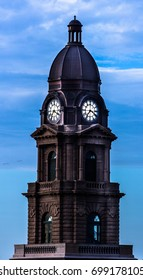 Close up shot of a clocktower on top of a courthouse in Texas at dawn