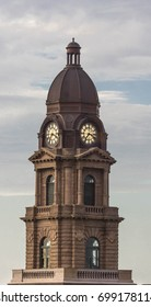Close up shot of a clocktower on top of a courthouse in Texas