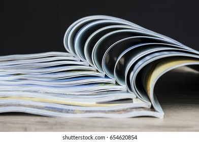 Close up shot of colorful magazines arranged together