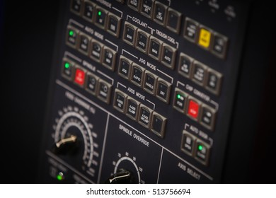 Close up shot of a control panel with many buttons.