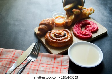 Close up shot of Croissant and bekery ingredients on black background