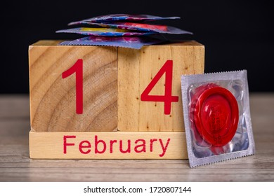 Close up shot of date February 14 with condoms