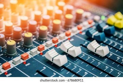 close up shot detail sound mixer control panel button in natural light