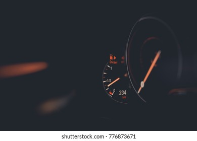 Close up shot with the digital speedometer of a car.