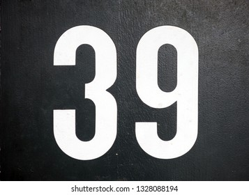 Close up shot of door with numerals 39, number thirty nine