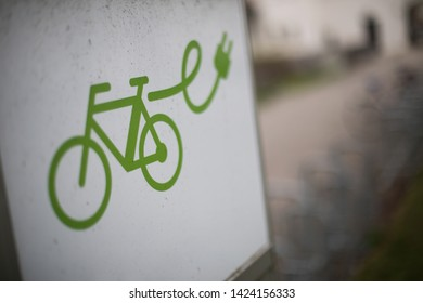 Close up shot of an electrical bike charging station sign with shallow depth of field.