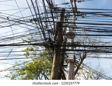 Close up shot of electricity power line in Bangkok, Thailand.High voltage power pole with wires tangled,Wire and cable clutter. Potential danger from a mess of wires at Bohol, Phillipines
